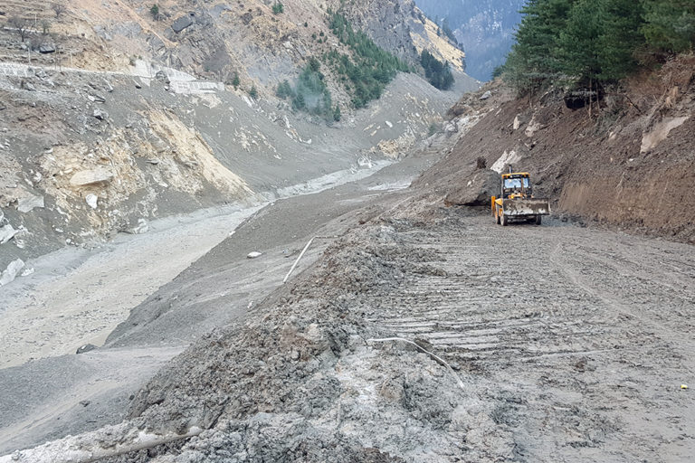 A landslide triggered snow/ice avalanche in the upper catchment of the Rishiganga river and caused severe damage downstream. Photo by Hridayesh Joshi.