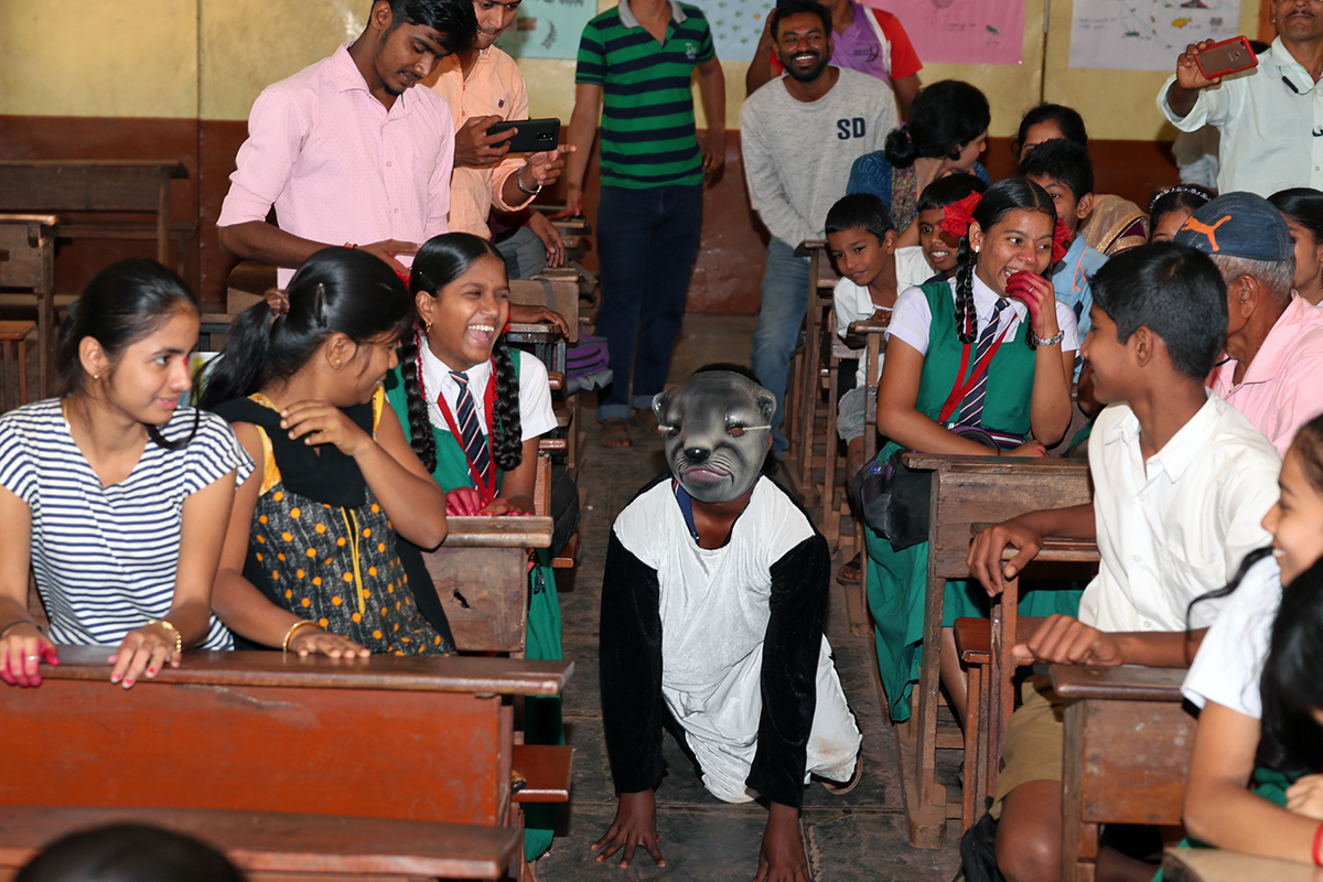 A child dressed up as an otter in a play. Photo by Malhar Indulkar.