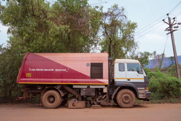 A sweeper truck to clean the dust on the road by trucks carrying iron ore. Photo by Neil D'souza.