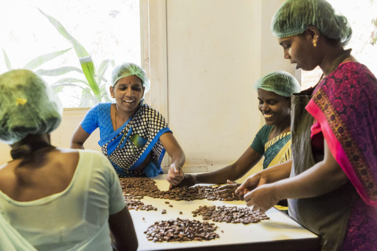 An all-women's team led by Saraswathi Murthy makes chocolates at Mason & Co. in Auroville, Puducherry. Saraswathi who leads the women in the factory, was first spotted by founders Jane Mason and Fabien Bontems and trained by them in 2013. Photo courtesy Mason & Co.