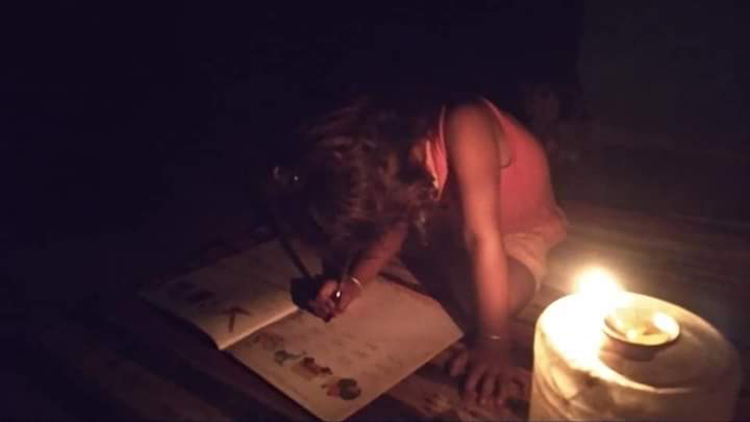 Ramvishal's eight-year-old daughter studying in the light of a kerosene lamp in Kotagunjapur village of Panna district of Madhya Pradesh. The villagers have been waiting for decades for the electricity to come to their village. Photo by Ramvishal Gond