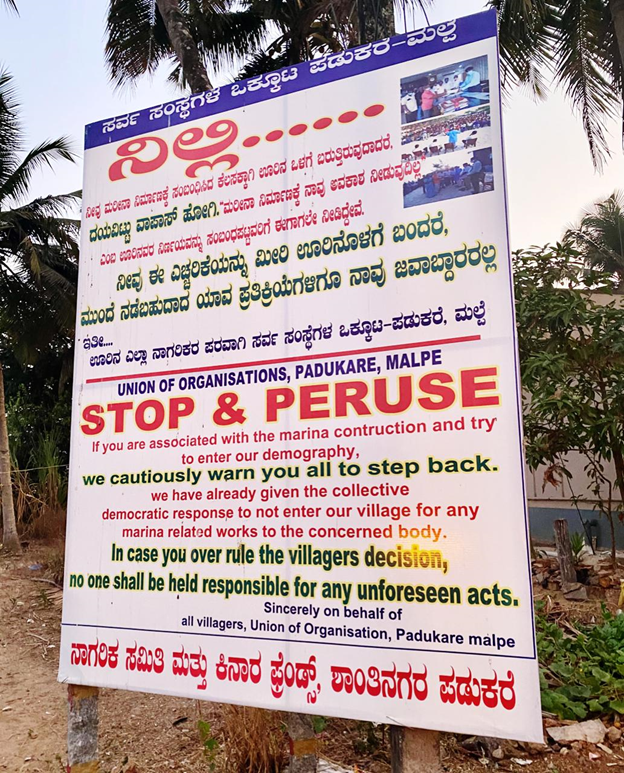 Villagers along with several organisations, came together to put up a warning flex on the beach. Photo by Spandana W.