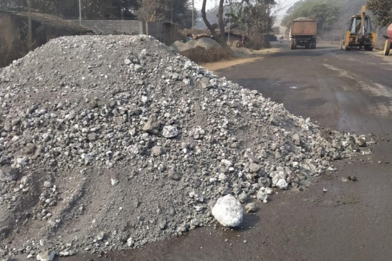 The locals allege that the slag from the sponge iron factory is being dumped on the road on pretext of road repair. Photo by Sarita Barpanda and Naresh Meher.