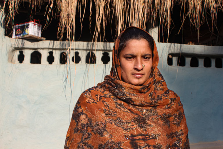 A young Van Gujjar mother of Diyawali village in the forest, is hopeful that her family will be resettled with new land so that she can send her daughter to school. Image credit: Radhika Gupta