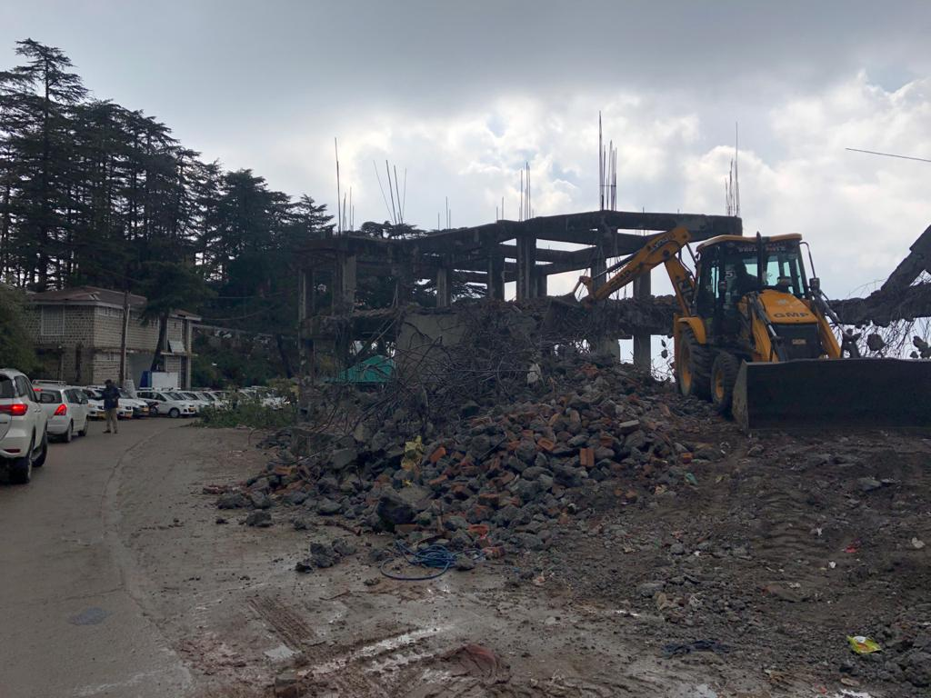 The illegal hotel construction being demolished at the order of the Supreme Court. Photo by Meenakshi Kapoor.