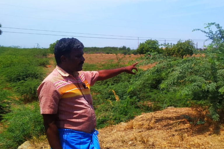 Murugan, one of the protest leaders of Kumarettiyapuram village, showing the compound wall of Sterlite at his village where work for a second smelting unit was happening in 2018. Photo by M. Kalyanaraman.