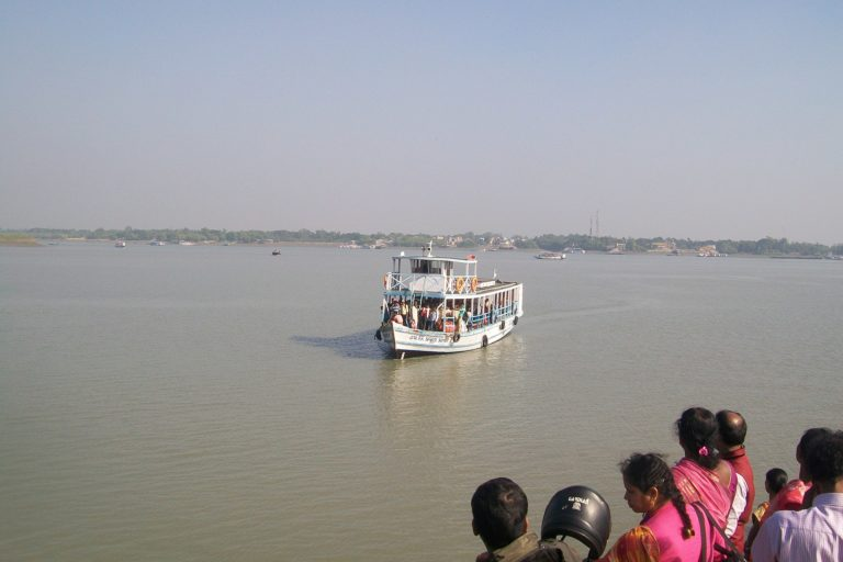 People waiting for a ferry in the Sundarban region of South 24 Parganas in West Bengal. Photo by Pinakpani/Wikimedia Commons.