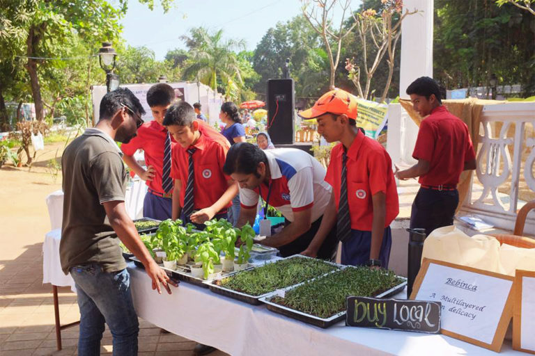 Students marketing microgreens and seedlings at the Konkan Fruit Fest in 2017.