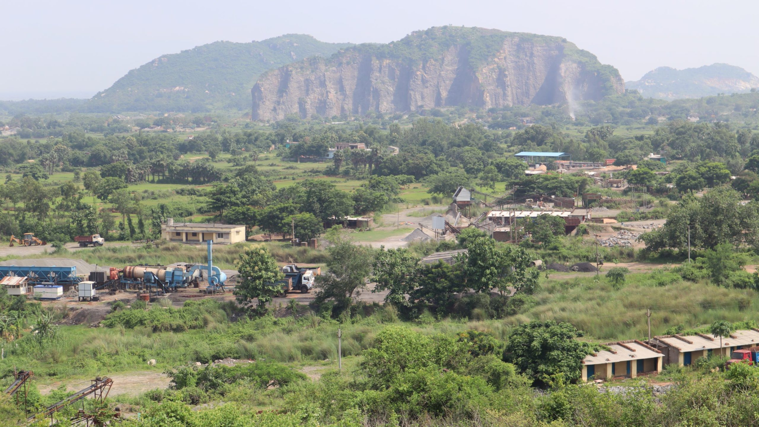 A vantage view of a stripped hill with many stone crushing and other units in the region. Photo by Manish Kumar.