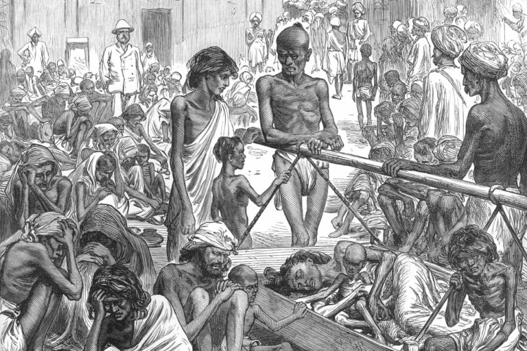 Famine-affected people waiting for relief in Bangalore, 1877. Photo by the Illustrated London News/Wikimedia Commons.