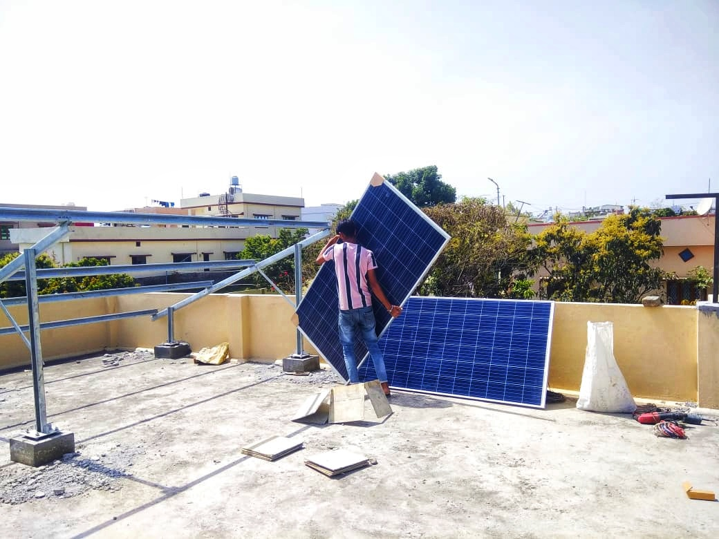 Solar panels being installed under the scheme. According to the norms of the scheme, any interested party is required to deposit Rs. 300,000 and mandatorily take a bank loan of Rs. 700,000 from the banks. Photo by Varsha Singh