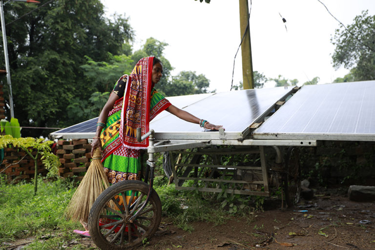 Women-led group take care solar pumps after receiving them from the government. Photo by Srikant Chaudhary